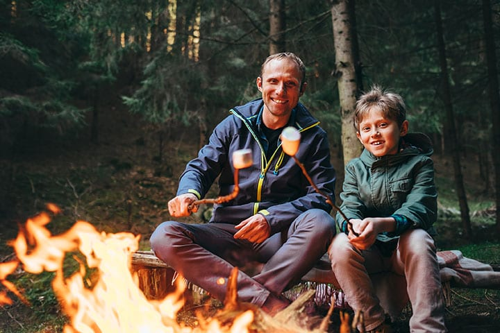 Father & son making roasting marshmallows over a fire in Maumee Bay State Park in Oregon Ohio